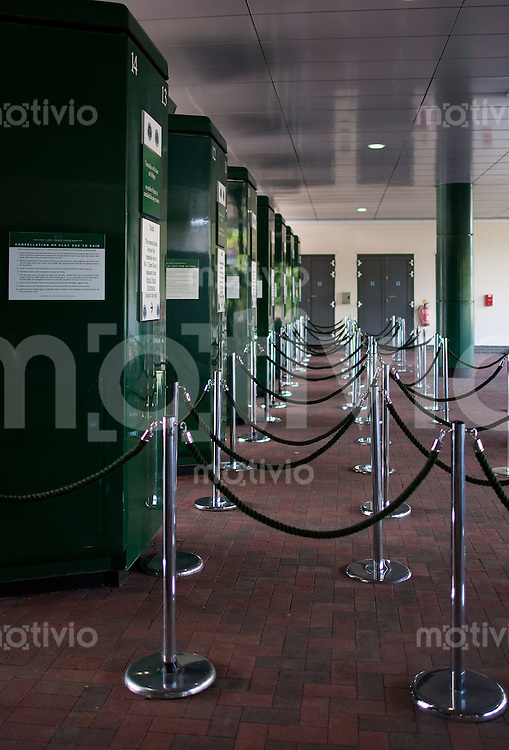 Turnstiles at one of the entrances. Preparation for The Wimbledon Championships 2010 The All England Lawn Tennis & Croquet Club  Sunday Pre Championships Sunday 21/06/2010