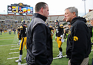October 26 2013: Northwestern Wildcats head coach Pat Fitzgerald and Iowa Hawkeyes head coach Kirk Ferentz talk before the start of the NCAA football game between the Northwestern Wildcats and the Iowa Hawkeyes at Kinnick Stadium in Iowa City, Iowa on October 26, 2013. Iowa defeated Northwestern 17-10 in overtime.