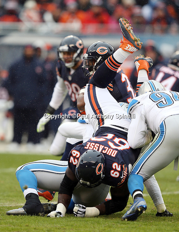 Chicago Bears offensive guard Vladimir Ducasse (62) gets upended during the NFL week 17 regular season football game against the Detroit Lions on Sunday, Jan. 3, 2016 in Chicago. The Lions won the game 24-20. (©Paul Anthony Spinelli)