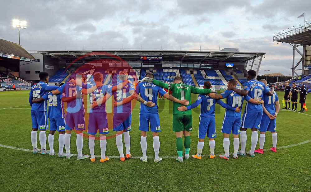 Peterborough United players join together for a minute silence in remembrance of the people who died in the Shoreham air crash - Mandatory byline: Joe Dent/JMP - 07966386802 - 25/08/2015 - FOOTBALL - ABAX Stadium -Peterborough,England - Peterborough United v Charlton Athletic - Capital One Cup - Second Round