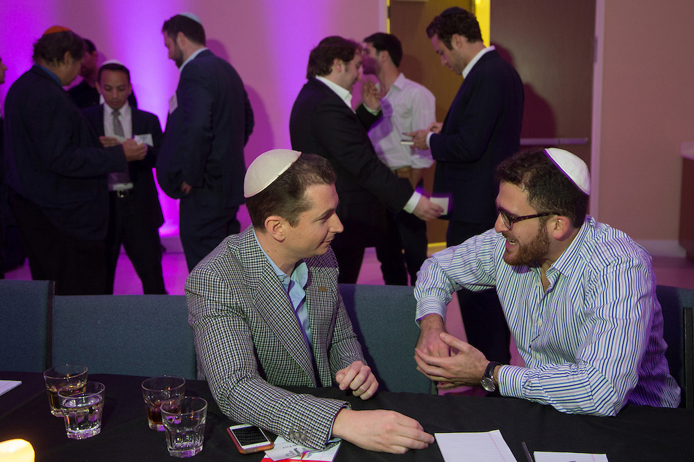 FEBRUARY 5, 2015----MIAMI, FLORIDA---PHOTO BY ANGEL VALENTIN<br /> Kyle Faro, left, a financial advisor, and Salomon V. Bagdadi, attorney, chat at the Rok Family Shul Chabad Downtown Jewish Center in the Brickell area of Miami. The center hosted a networking roundtable event for young Jews, mostly non-Orthodox. Real Estate investment and development was the topic discussed.