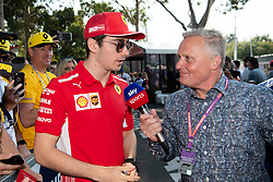 March 16, 2019 - Albert Park, VIC, U.S. - ALBERT PARK, VIC - MARCH 16: Scuderia Ferrari Mission Winnow driver Charles Leclerc talks to commentator Johnny Herbert at The Australian Formula One Grand Prix on March 16, 2019, at The Melbourne Grand Prix Circuit in Albert Park, Australia. (Photo by Speed Media/Icon Sportswire) (Credit Image: © Steven Markham/Icon SMI via ZUMA Press)