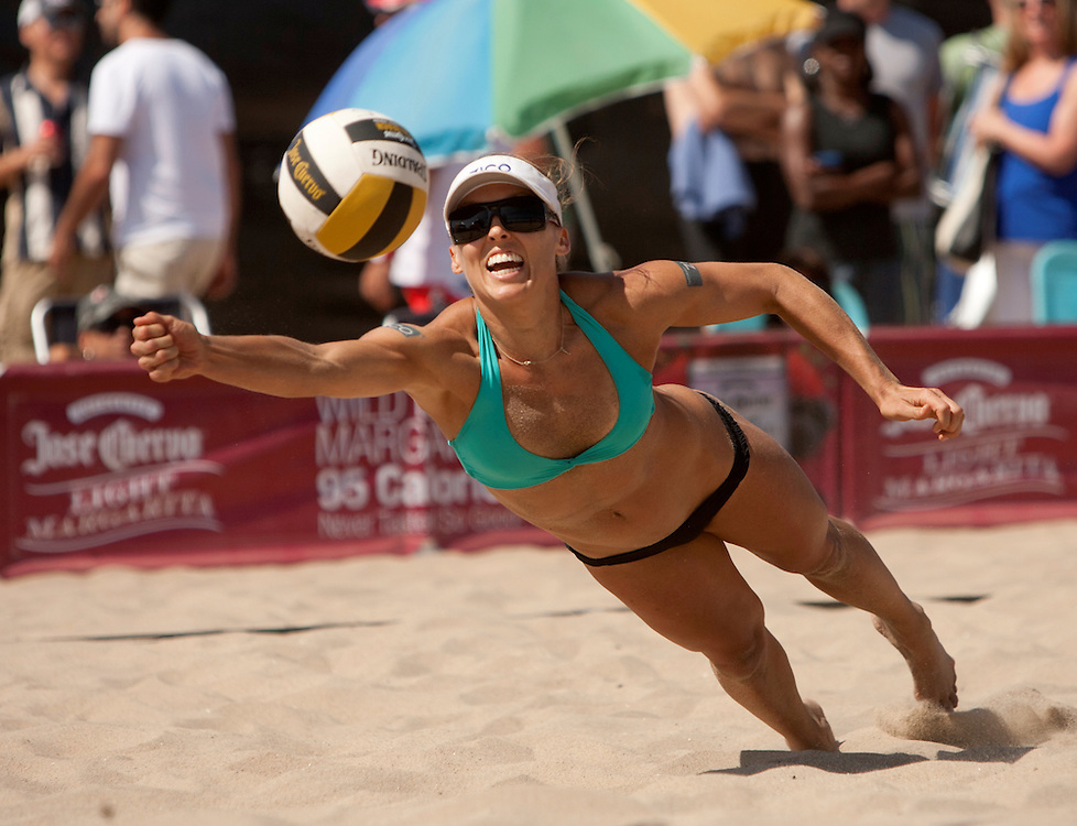 Manhattan Beach, CA - August 25th, 2012 - Brooke Niles playing with partner Tyra Turner, dives for a ball hit by opponents Nicole Branagh/Brittany Hochevar in the Manhattan Beach Open Jose Cuervo Beach Volleyball tournament held in Manhattan Beach, CA. Branagh/Hochevar won the match 22-24, 21-19, 15-11. Photo by Wally Nell/DIG Magazine