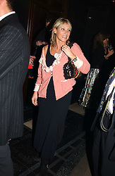 INGRID TARRANT at a party to celebrate a new collection of sexy underware by Janet Reger called 'Naughty Janet' held at 5 Cavendish Square, London on 19th October 2004.<br />