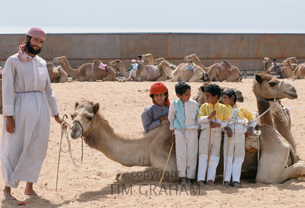 Camel racing with boy jockeys at Al Ain in Abu Dhabi, United Arab Emirates, Middle East