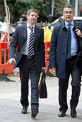 © London News Pictures. 26/09/2013 . London, UK. VLADIMIR ANTONOV (left) arriving at Westminster Magistrates Court in London for the start of his full extradition hearing. Antonov, who is the former owner of Portsmouth Football Club, and his business partner Raimondas Baranauskas, are accused of asset stripping hundreds of millions of pounds from Snoras Bank. Photo credit : Ben Cawthra/LNP