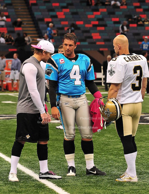 "New Orleans Saints kicker John Carney, recently resigned, is seen giving instructions to New Orleans kicker Garrett Hartley while the Carolina Panthers kicker John Kasey watches and gives advice prior to the Saints -v-Panthers game Sunday Oct. 3,2010. Carney went on to kick three feild goals to help the saints win while Hartley did not play at all. The NFL has gone ""Pink"" for October in honor of Breast Cancer Awareness. The Saints went on to win 16-14. John Carney kicked three field goals to help the Saints win. PHOTO©SuziAltman.com"