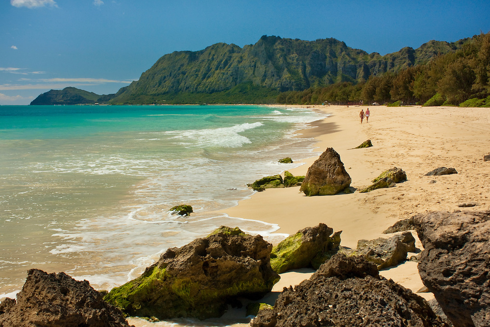 Couple walking on Waimanalo beach on Oahu, Hawaii