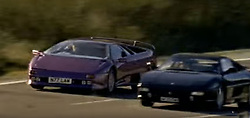 """August 2, 2017 - inconnu - A stunning Lamborghini Diablo sports car featured in funk soul band Jamiroquai's hit single, Cosmic Girl, is up for grabs atr more than half a million poundsThe viola-metallic coloured Italian-made classic – priced at £549,995 GBP / € 615.000 Euros / $726,500 USD was one of only 16 right-hand-drive models built.It was one of two identical cars that featured in the 1996 music video driven by band singer and avid car collector Jay Kay.The first was written-off following a crash on the video set and had to be replaced. The car for sale replaced the damaged Diablo, but also had an unfortunate incident of its own. DDuring the filming a precision camera fell from a height, knocking out the car's windscreen, but Jay Kay , who personally owned the vehicle, decided to drive the car for the remainder of the filming without any front windscreen protection.The car ios now being sold on UK website Auto Trader.Auto Trader Car's Editor, Andy Pringle, said, """"You'll often find rare, exotic and famous cars on Auto Trader, but it's not every day you'll find one from hyperspace.""""One of three classic supercars used in the Cosmic Girl video - it's the only one Jay Kay, known as the 'Space Cowboy' actually owned ."""" So although it might price-out most music fans at over half a million pounds - there could be a love affair reunited on the cards if Jay Kay's browsing Auto Trader.""""It is being sold through Amari Supercars based in Preston, Lancashire , i9n the UK.The dealer is selling the car through Auto Trader and claims to be the only car dealership to have owned the car, having been the first to sell the car to Jamiroquai in 1996. Since then the car has had two owners, but returned to Amari Supercars recently after spending some time in Germany under the ownership of a Lamborghini collector. # LA LAMBORGHINI DU CLIP 'COSMIC GIRL' DE JAMIROQUAI A VENDRE (Cr"""