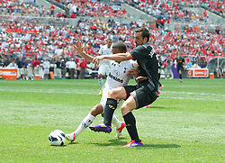 BALTIMORE, MD - Saturday, July 28, 2012: Liverpool's Jose Enrique in action against Tottenham Hotspur during a pre-season friendly match at the M&T Bank Stadium. (Pic by David Rawcliffe/Propaganda)