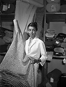 "21/05/1959<br /> 05/21/1959<br /> 21 May 1959<br /> Actress Dana Wynter selecting tweeds at Gaeltarra Eireann, Westland Row, Dublin. Miss Wynter was in Dublin for the premier of the film ""Shake Hands with the Devil"". Picture shows her picking a piece of Round Tower Irish tweed at the showroom."