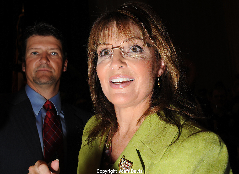 ATLANTA, GA - August 9, 2010: Sarah and Todd Palin greet supporters after Sarah Palin endorsed Karen Handel in the Georgia Republican Gubernatorial Runoff for governor at the Buckhead InterContinental Hotel. &quot;Are you ready to elect a pro-life, pro-Second Amendment, commonsense constitutional conservative, who will fight like a mama grizzly for you and the values that you hold dear?&quot; Palin asked the packed ballroom of an estimated 3000 people. <br /> <br /> Handel lost the runoff to Nathan Deal one day later.