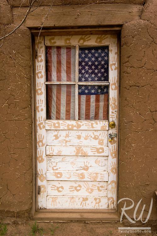 U.S. Flag Hanging on Door, Taos Pueblo, New Mexico