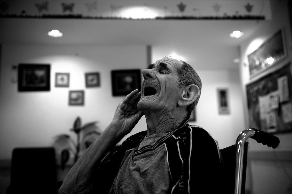 Holocaust survivor Meir Moskowitz, 82, sits in a wheelchair in the Shaar Menashe Mental Health Center for Holocaust survivors in Pardes Hanna, Israel on Nov 16, 2010. Moskowitz experienced  pogroms in Romania and had long days inside a cattle car.
