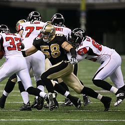 2007 October, 21: New Orleans Saints linebacker Scott Shanle (58) reaches for the tackle of Falcons running back Jerious Norwood (32) during a 22-16 win by the New Orleans Saints over the Atlanta Falcons at the Louisiana Superdome in New Orleans, LA.