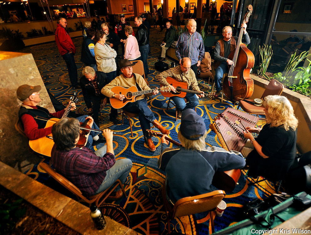 A group of attendees holds one of many impromptu jam sessions in the atrium of Jefferson City's Capitol Plaza Hotel during the opening day of the 38th annual Society for the Preservation of Bluegrass Music of America (SPBMA) Bluegrass Music Awards and 29th annual Midwest Convention.