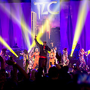 January 30, 2013 - New York, NY : The rapper Doug E. Fresh, center, performs with the band TLC as part of VH1 Super Bowl Blitz at the Beacon Theatre in Manhattan on Thursday night. In orange suits in background are TLC's Tionne 'T-Boz' Watkins, center left, and Rozonda 'Chilli' Thomas, center right. CREDIT: Karsten Moran for The New York Times