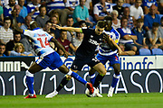 Tom Lawrence (10) of Derby County battles with Sone Aluko (14) of Reading and Andy Yaidom (3) of Reading during the EFL Sky Bet Championship match between Reading and Derby County at the Madejski Stadium, Reading, England on 3 August 2018. Picture by Graham Hunt.