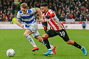 Brentford forward Saïd Benrahma (10) attacking, Queens Park Rangers defender Todd Kane (2), during the EFL Sky Bet Championship match between Brentford and Queens Park Rangers at Griffin Park, London, England on 11 January 2020.