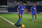 AFC Wimbledon midfielder Tyler Burey (32) dribbling during the EFL Trophy group stage match between AFC Wimbledon and Stevenage at the Cherry Red Records Stadium, Kingston, England on 6 November 2018.
