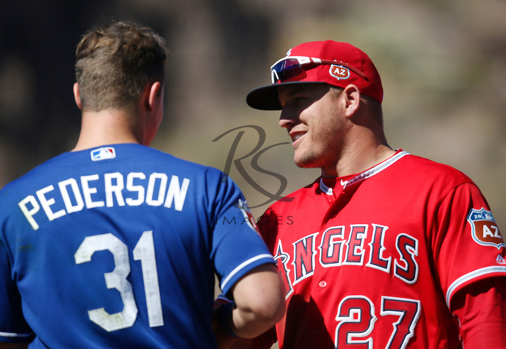 Mar 9, 2016; Tempe, AZ, USA; Los Angeles Dodgers center fielder Joc Pederson (31) and Los Angeles Angels center fielder Mike Trout (27) talk in the fourth inning during a spring training game at Tempe Diablo Stadium. Mandatory Credit: Rick Scuteri-USA TODAY Sports