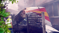© Licensed to London News Pictures. 11/04/12. A light aircraft that crashed into two houses, killing the pilot, probably suffered a fuel supply problem, an air accident report revealed today. FILE PICTURE DATED 29/07/2011. Salford, UK. A light aircraft has crashed in to the side of a house near Barton Aerodrome, in Salford, Greater Manchester. No one was killed. Photo credit : Joel Goodman/LNP