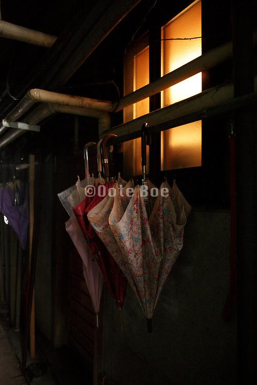 umbrellas hanging by window