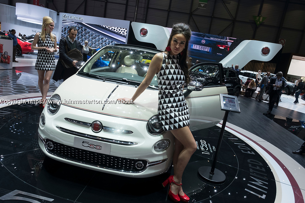 Models posing beside Fiat 500 car at 87th Geneva International Motor Show in Geneva Switzerland 2017