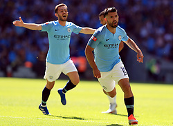 "Manchester City's Sergio Aguero celebrates scoring his side's first goal of the game during the Community Shield match at Wembley Stadium, London. PRESS ASSOCIATION Photo. Picture date: Sunday August 5, 2018. See PA story SOCCER Community Shield. Photo credit should read: Mike Egerton/PA Wire. RESTRICTIONS: EDITORIAL USE ONLY No use with unauthorised audio, video, data, fixture lists, club/league logos or ""live"" services. Online in-match use limited to 75 images, no video emulation. No use in betting, games or single club/league/player publications."