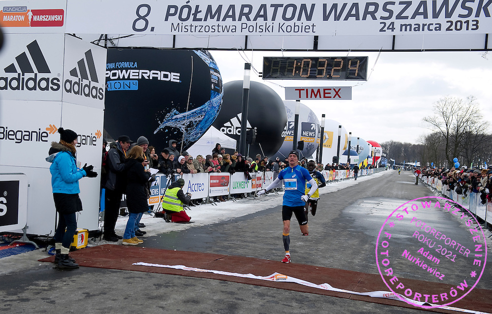 Marcin Chabowski of Poland on finish line The 8th Warsaw Half Marathon on March 24, 2013...Poland, Warsaw, March 24, 2013...Picture also available in RAW (NEF) or TIFF format on special request...For editorial use only. Any commercial or promotional use requires permission...Photo by © Adam Nurkiewicz / Mediasport