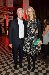 SIR RONALD & LADY COHEN at the Tunnel of Love art and fashion auction and dinner in aid of the British Heart Foundation held at One Mayfair, London on 12th November 2013.
