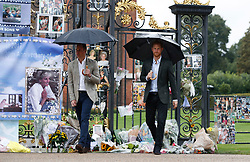 The Duke of Cambridge and Prince Harry depart after viewing tributes to Diana, Princess of Wales attached to the Golden Gates of Kensington Palace, London, ahead of the 20th anniversary of their mother's death.