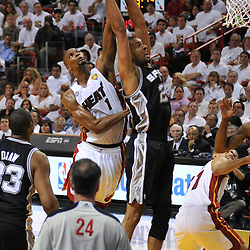 Jun 18, 2013; Miami, FL, USA; San Antonio Spurs power forward Tim Duncan (21) rebounds against Miami Heat center Chris Bosh (1) during the first quarter of game six in the 2013 NBA Finals at American Airlines Arena.  Mandatory Credit: Derick E. Hingle-USA TODAY Sports