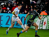 Rugby Union - 2019 / 2020 European Rugby Heineken Champions Cup - Pool Four: Ospreys vs. Racing 92<br /> <br />  Juan Imhoff of Racing chips ahead covered by  Luke Morgan of Ospreys, at the Liberty Stadium.<br /> <br /> COLORSPORT/WINSTON BYNORTH