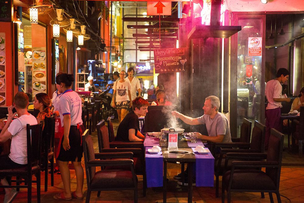 Diners sit outside eating in restaurants on Pub Street in downtown Siem Reap, Cambodia, Asia. Siem Reap is the capital city of the Siem Reap Province.  Pub Street is a famous destination for lively nightlife for tourist and travellers as it restaurants and bars stay open late.  (photo by Andrew Aitchison / In pictures via Getty Images)