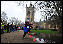 Baroness Kramer Lib Dem , takes part in the MP's and Lords race against political Journalist in the Rehab Parliamentary Pancake Shrove Tuesday race a charity event which sees MPs and Lords joined by media types in a race to the finish. Victoria Tower Gardens, Westminster, Tuesday February 12, 2013. Photo By Andrew Parsons / i-Images