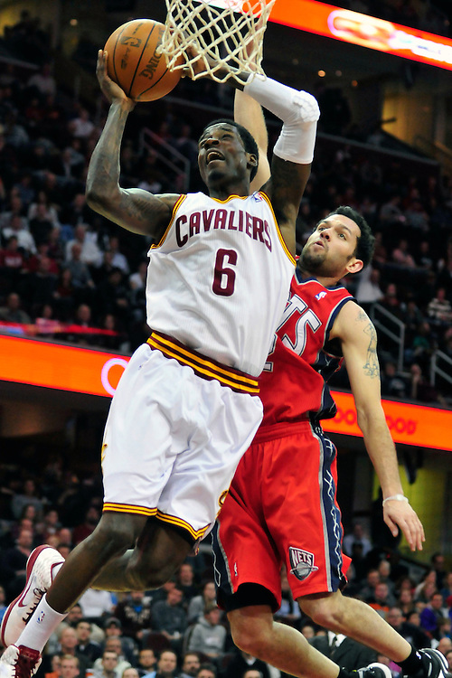 March 23, 2010; Cleveland, OH, USA; Cleveland Cavaliers guard Manny Harris (6) shots over New Jersey Nets point guard Jordan Farmar (2) during the second quarter at Quicken Loans Arena. Mandatory Credit: Jason Miller-US PRESSWIRE