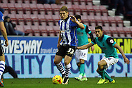 Martyn Waghorn of Wigan Athletic on the ball. Skybet football league championship match , Wigan Athletic v Blackburn Rovers at the DW Stadium in Wigan, Lancs on Saturday 17th Jan 2015.<br /> pic by Chris Stading, Andrew Orchard sports photography.
