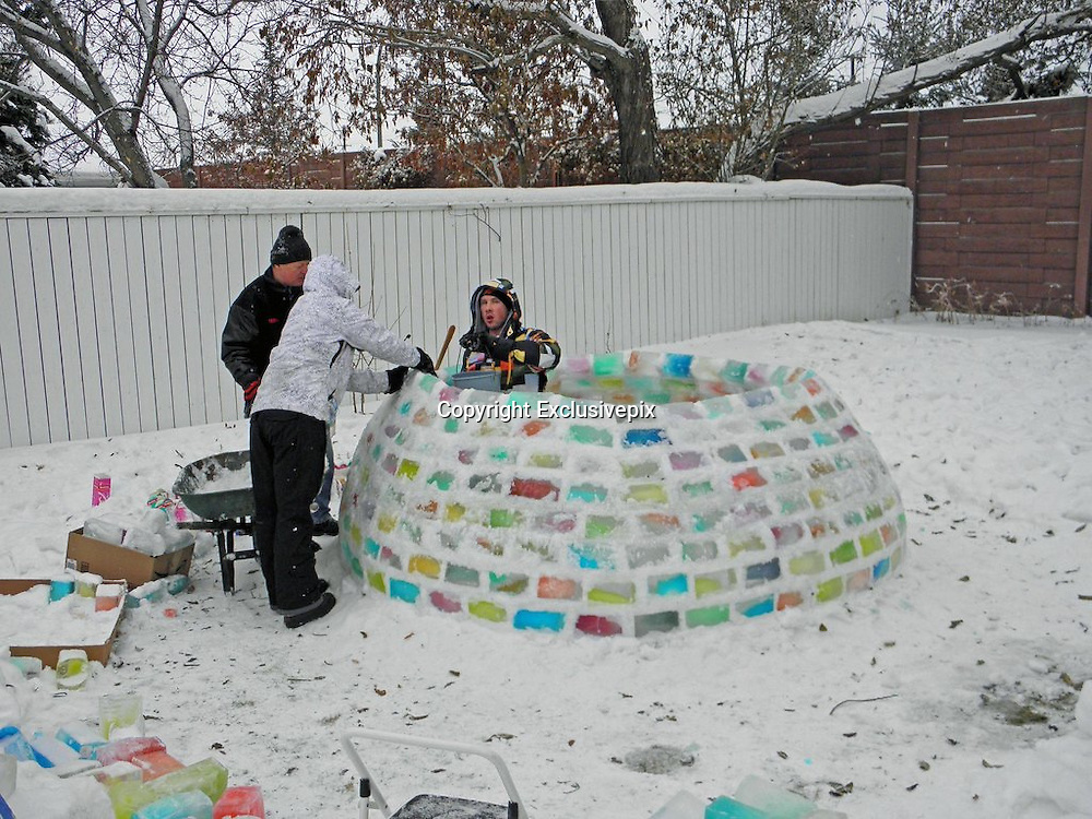 That's one cool hobby! Man spends five days building an igloo from hundreds of frozen milk cartons<br /> <br /> A man has found an ingenious way to pass the long winter hours of sub-zero temperatures in Canada - by building this impressive igloo. <br /> The shelter was built by Daniel Gray, who is from New Zealand, while he visited his girlfriend Kathleen Starrie in Canada. <br /> The project began back in October when Miss Starrie began collecting hundreds of milk cartons at her home in Edmonton, washing and filling them with colored water. <br /> The idea was dreamed up by Miss Starrie's mother Brigid Burton to keep her daughter's boyfriend occupied during his five-week trip. <br /> The cartons were then frozen to turn them into 'bricks'. Mr Gray used snow and water to pack around 500 together in a spherical shape with the help of his girlfriend, her parents and a neighbor.<br /> <br /> In all, the igloo took five days to build in the backyard of Miss Starrie's parents' home and around 150 hours of labor.<br /> While the careful construction took place, the temperature often dropped to minus 25F but Mr Gray said that he could not give up.<br /> <br /> <br /> Mr Gray told the Global Edmonton: 'I thought we'd just take the bricks of ice and just kind of, almost throw them out there and make an igloo. (It was) a lot more difficult, truly.'<br /> The igloo is the traditional hunting home of the Inuit, an aboriginal tribe who live across the inhospitable Arctic region. <br /> Igloos have recently become a quirky feature of boutique hotels. The Iglu-Dorf is one of seven igloo villages across the Swiss Alps where guests pay up to $299 for a night's stay - and have access to restaurants, ice bars and hot tubs.<br /> The igloos are rebuilt every season in resorts in Andorra, Switzerland and Austria - including St Moritz, Gstaad and Davos-Klosters.<br /> © Daniel Gray/Exclusivepix