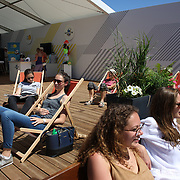 2017 French Open Tennis Tournament.  Tennis goers relax on deckchairs at the Lacoste store at the 2017 French Open Tennis Tournament at Roland Garros on May 25th, 2017 in Paris, France.  (Photo by Tim Clayton/Corbis via Getty Images)