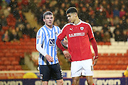 Coventry City defender Chris Stokes (3)  and Barnsley forward, on loan from Manchester United, Ashley Fletcher (18)  during the Sky Bet League 1 match between Barnsley and Coventry City at Oakwell, Barnsley, England on 1 March 2016. Photo by Simon Davies.