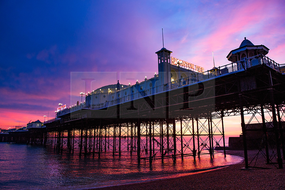 © Licensed to London News Pictures. 19/12/2017. Brighton, UK. A colourful sky above Brighton Palace Pier as the sun sets today, 19th December 2017. Photo credit: Hugo Michiels/LNP