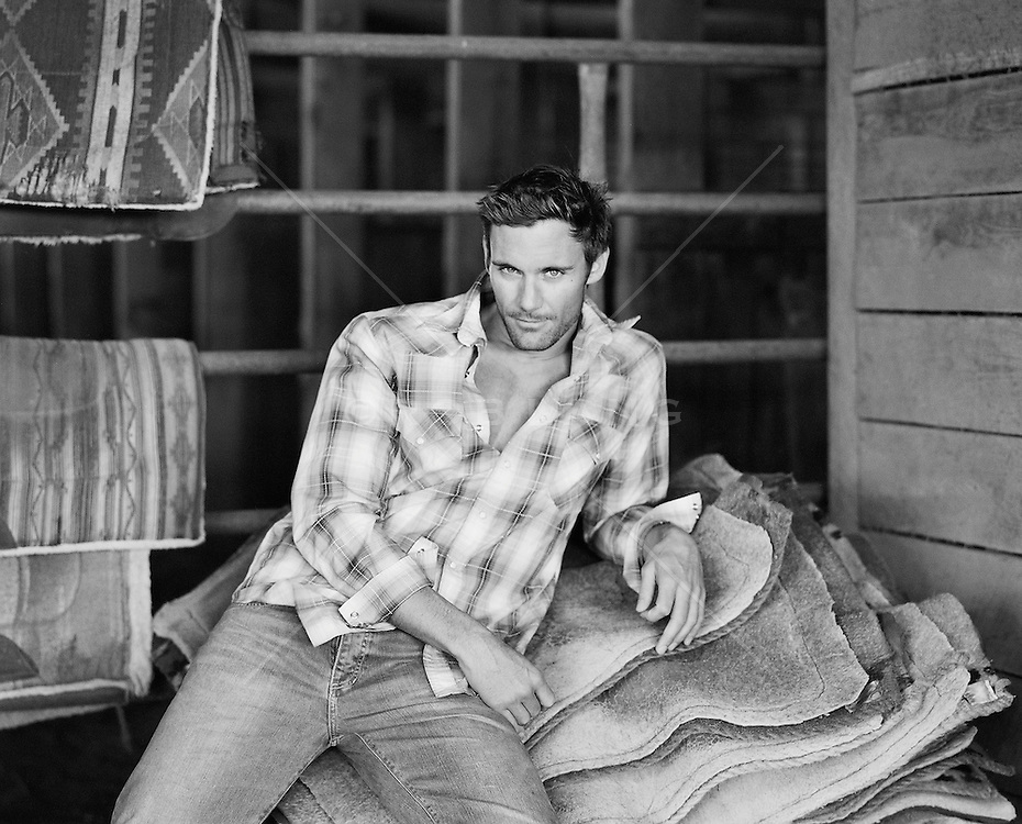 sexy man in a barn