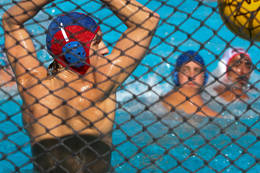 Fullerton Hornet goalkeeper Sam Feaster watches as the Santa Ana Dons find the goal during The Orange Empire Conference Tournament at Golden West College Pool in Huntington Beach,CA on Thursday, Nov. 6, 2014. (Photo by Charles Hall/challphotos.com)