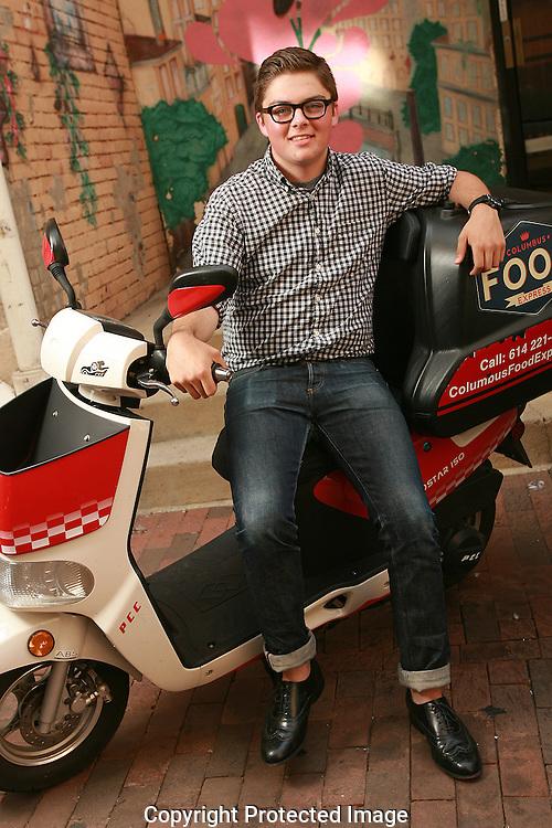 Jacob Taylor runs Columbus Food Express with his scooter.(Jodi Miller/Alive)