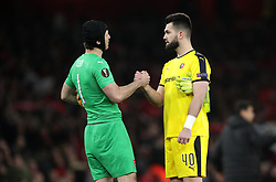 Arsenal goalkeeper Petr Cech (left) and Rennes' Tomas Koubek (right) after the final whistle