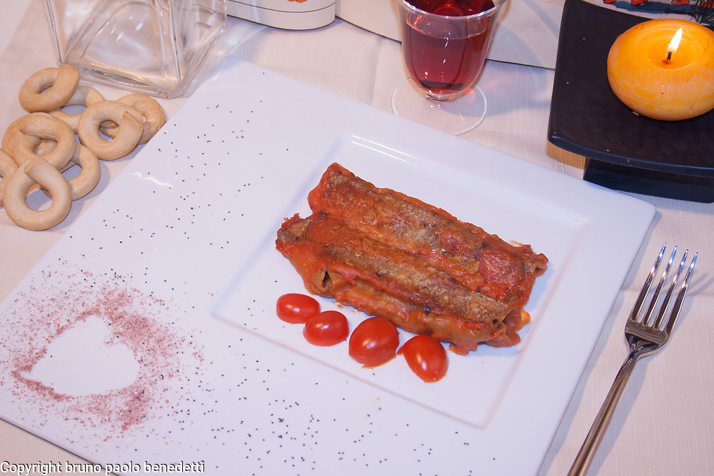 wild boar cannelloni close-up on white dish view from above plating on white dish