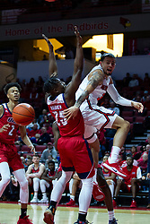 NORMAL, IL - December 18: Ricky Torres passes off the ball when challenged by Godwin Boahen during a college basketball game between the ISU Redbirds and the UIC Flames on December 18 2019 at Redbird Arena in Normal, IL. (Photo by Alan Look)