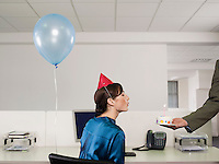 Woman having birthday party in office