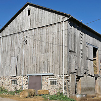 Barn under a bright blue sky